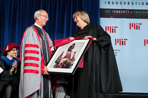 During the Inauguration of L. Rafael Reif (left), the 17th president of the Massachusetts Institute of Technology, Harvard President Drew Faust presented Reif with a framed photo of the John Harvard Statue decorated in MIT gear.