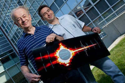 Federico Capasso (left), Patrice Genevet (right), and an international team of colleagues have demonstrated a new type of tightly controlled light wave that could eliminate signal loss in on-chip optical devices.