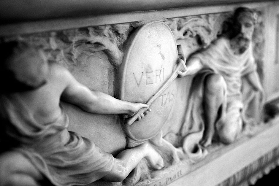 """Veritas,"" meaning ""truth,"" is Harvard's motto and is etched in a decorative marble molding on a mantelpiece in Loeb House. Veritas was a Roman goddess — the daughter of Saturn and the mother of Virtue. Stephanie Mitchell/Harvard Staff Photographer"