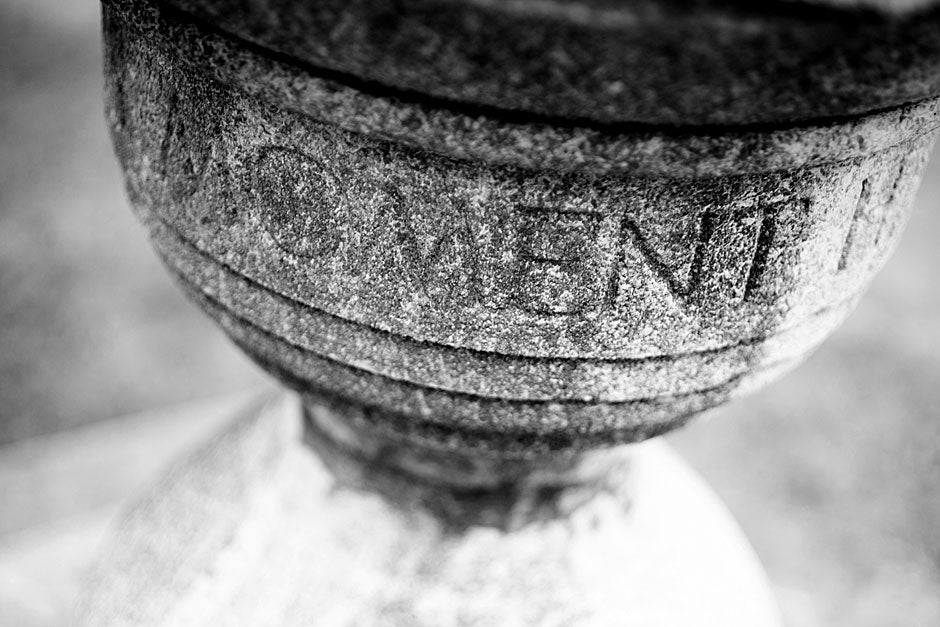 """On this moment hangs eternity"" — these words are etched into a pedestal near Holden Chapel, a gift from the Class of 1870. Rose Lincoln/Harvard Staff Photographer"