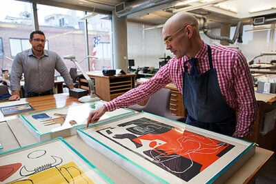 Paper conservators at the Weissman Preservation Center Adam Novak (left) and Christopher Sokolowski recently helped assess, repair, and reframe six Le Corbusier lithographs and one proof print from a Joan Miró etching. The artworks, most of them about 50 years old, came from the Carpenter Center for the Visual Arts.
