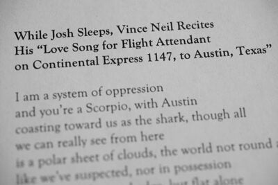 "A close-up image of the text to Josh Bell's poem, ""While Josh Sleeps, Vince Neil Recites His 'Love Song for Flight Attendant on Continental Express 1147, to Austin, Texas.'"""