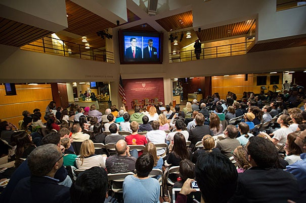 """A packed crowd gathered at the Harvard Kennedy School for a viewing of the first presidential debate and for a panel discussion, """"From Prep to the Podium,"""" a behind-the-scenes look at the work that goes into training candidates for the debates."""