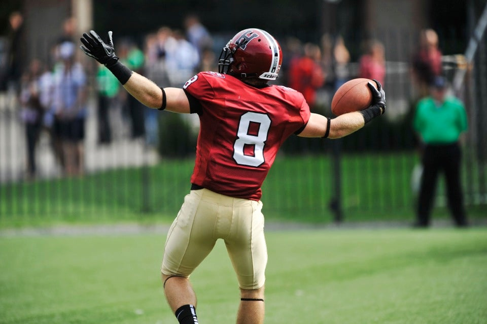 Crimson wide receiver Andrew Berg `14 celebrates the first of his three TD catches during the first half.  Berg tied the Harvard record for most TD catches by a player in a game.