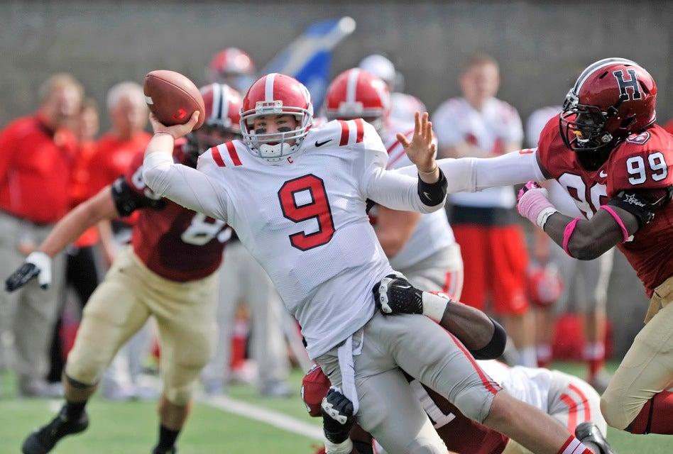 Crimson defensive end Zach Hodges `15 (right) pressures Cornell quarterback Jeff Matthews into an off-balance throw.