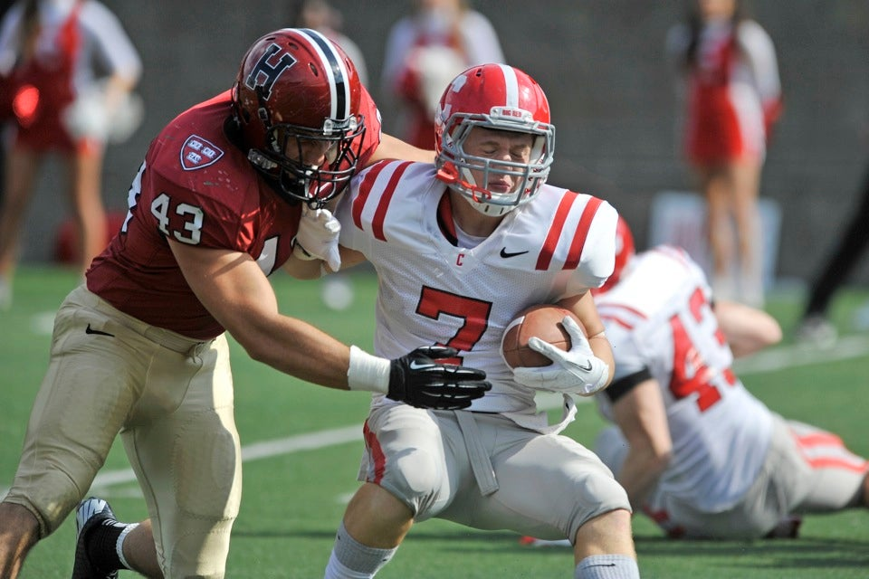 Crimson defensive end Danny Frate `14 closes in on Cornell wide receiver Grant Gellatly.