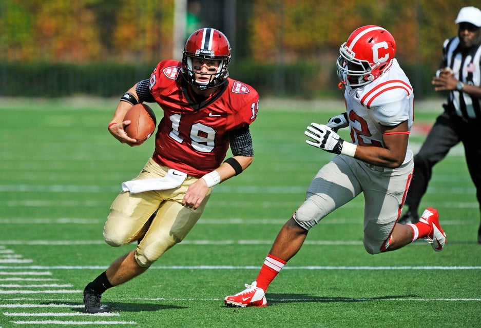 Crimson quarterback Colton Chapple `13 (center) runs out of the pocket and down the sideline on a long run.  Chapple threw for four TDs and rushed for a fifth, and was named the Ivy League Offensive Player of the Week for the second consecutive week.