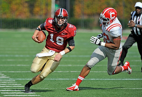 Quarterback Colton Chapple '13 runs out of the pocket and down the sideline on a long run. Chapple threw for four touchdowns and rushed for a fifth, and was named the Ivy League Offensive Player of the Week for a second consecutive week.