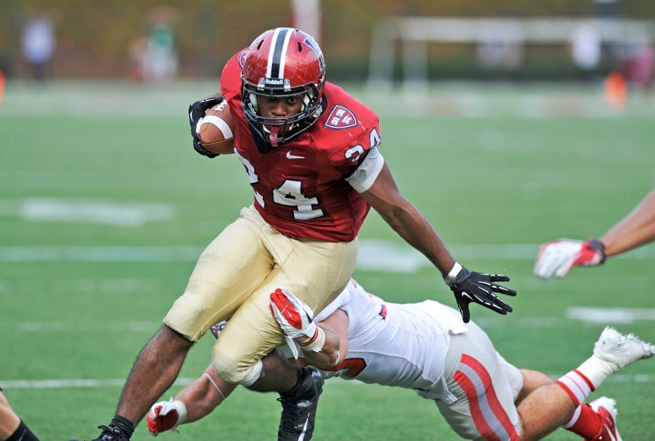 Crimson running back Treavor Scales `13 dodges a Cornell player on a long run downfield.  Scales rushed for 106 yards and scored a TD.