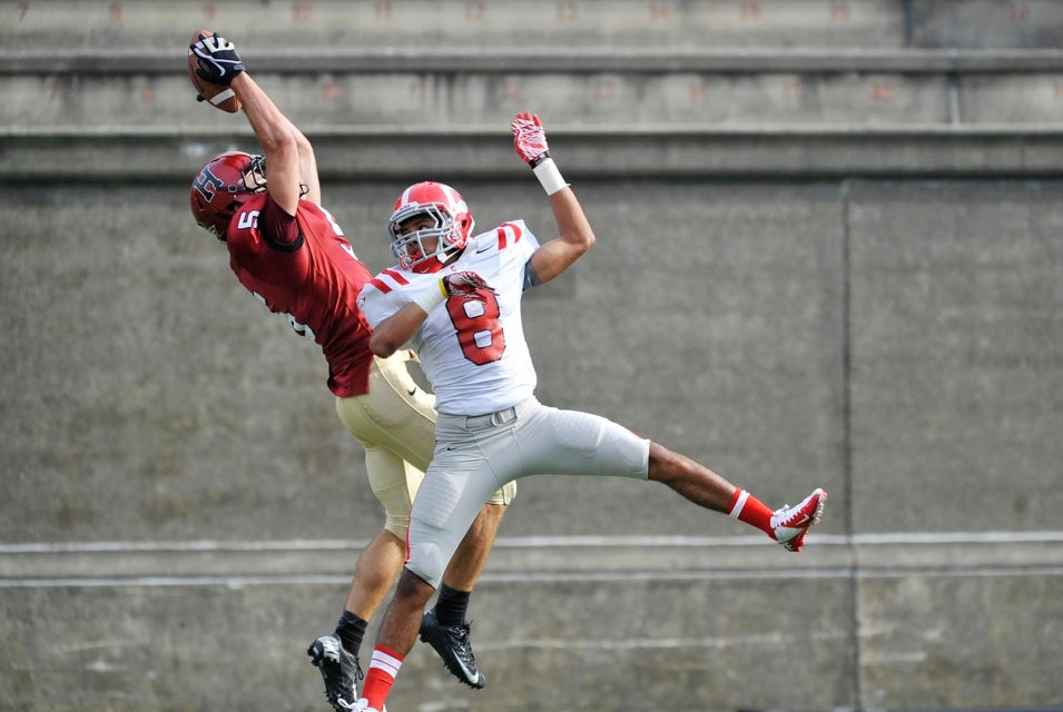 Crimson wide receiver Ricky Zorn `14 outleaps a Cornell defender to haul in a pass for a TD.