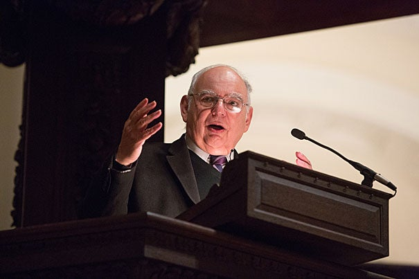 """Ernesto Cortés Jr. received the Robert Coles """"Call of Service"""" Award for his efforts to empower people to improve their lives and circumstances. After receiving his award, Cortés climbed up to the Memorial Church's grand pulpit, 15 feet above the audience, to deliver his lecture. """"I feel like I'm in 'Moby Dick,'"""" he chuckled."""