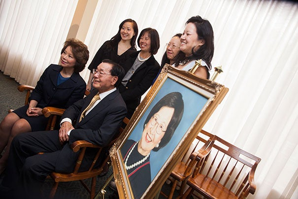 Announcing a $40 million gift from the James Si-Cheng Chao and Family Foundation were Angela Chao (back row, from left), Christine Chao, May Chao, and Grace Chao, Elaine Chao (front row, left), and James S.C. Chao. They are seated next to a portrait of the late family matriarch, Ruth Mulan Chu Chao.