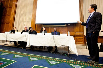 A panel discussion at Harvard University exploring law, history, and the 2012 election included moderator Jill Lepore (from left), and panelists Alex Keyssar, Annette Gordon-Reed, Elizabeth Hinton, Kenneth Mack, and Jed Shugerman (standing).
