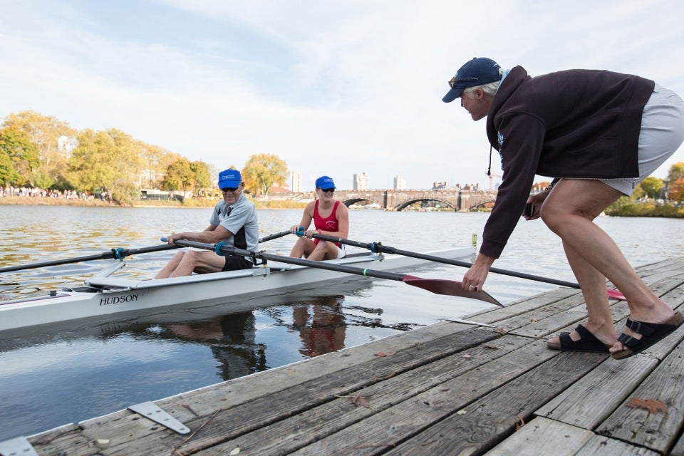 Kerry Herman pushes the two off into the Charles River.