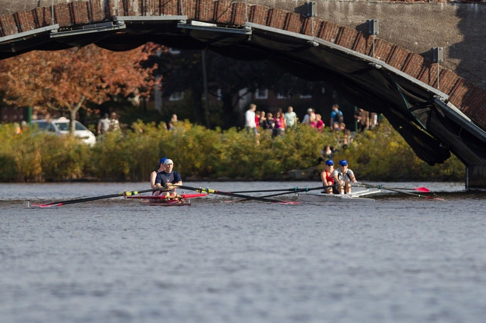 Father and daughter (right boat) make their way to the starting line before the race.