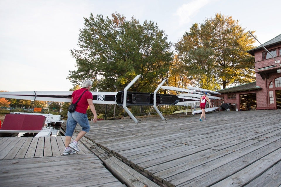Kathryn Keeler assists daughter Abigail with loading the boat back into the boathouse.