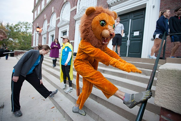 Dudley Athletics Fellow Seth Peabody incorporated Halloween into the Wednesday Harvard On The Move run as he stretched his paws before hitting the pavement.