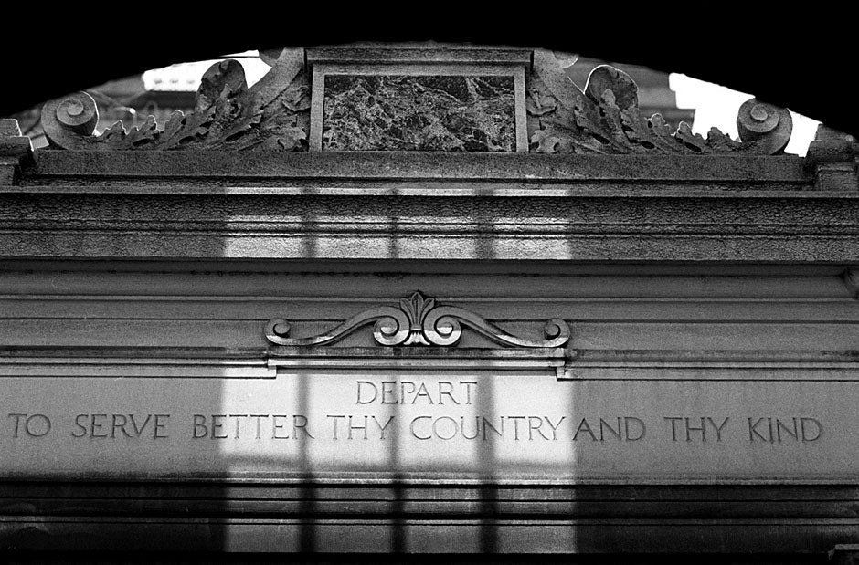 """""""Enter to grow in wisdom"""" are the words Harvard President Charles Eliot had inscribed on Dexter Gate near Wigglesworth Hall. As you leave, the other side reminds us to """"Depart to serve better thy country and thy kind."""" Rose Lincoln/Harvard Staff Photographer"""