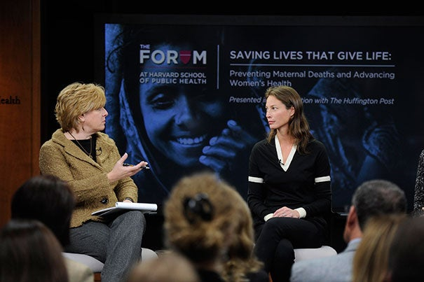During The Forum at Harvard School of Public Health event, panel moderator Lisa Belkin (left) talks to Christy Turlington Burns, founder of Every Mother Counts. Nine years ago, Turlington Burns began researching the issue of women dying of childbirth-related complications when she suffered a postpartum hemorrhage after giving birth to her daughter.