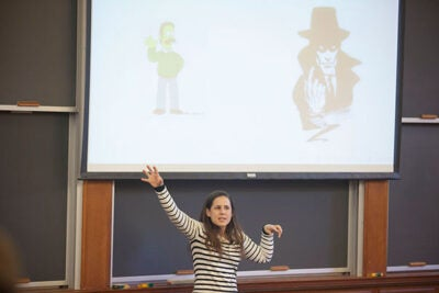 Why we write a check or cast a ballot is often for the same reason that we buy Girl Scout cookies or Tupperware: pressure to conform with a group, Betsy Sinclair told her Harvard Law School audience.