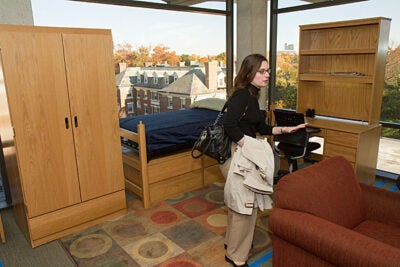 "For Carina Myteveli (pictured), administrative operations officer with FAS resources, the open house and student tours of the displays offered a chance to think outside the box. ""Do you like the fabric, the arms of a chair, the table? All these pieces can be customized to students' overall feedback and specifications. We want to give them the opportunity to make that space their own, as much as we can,"" she said."