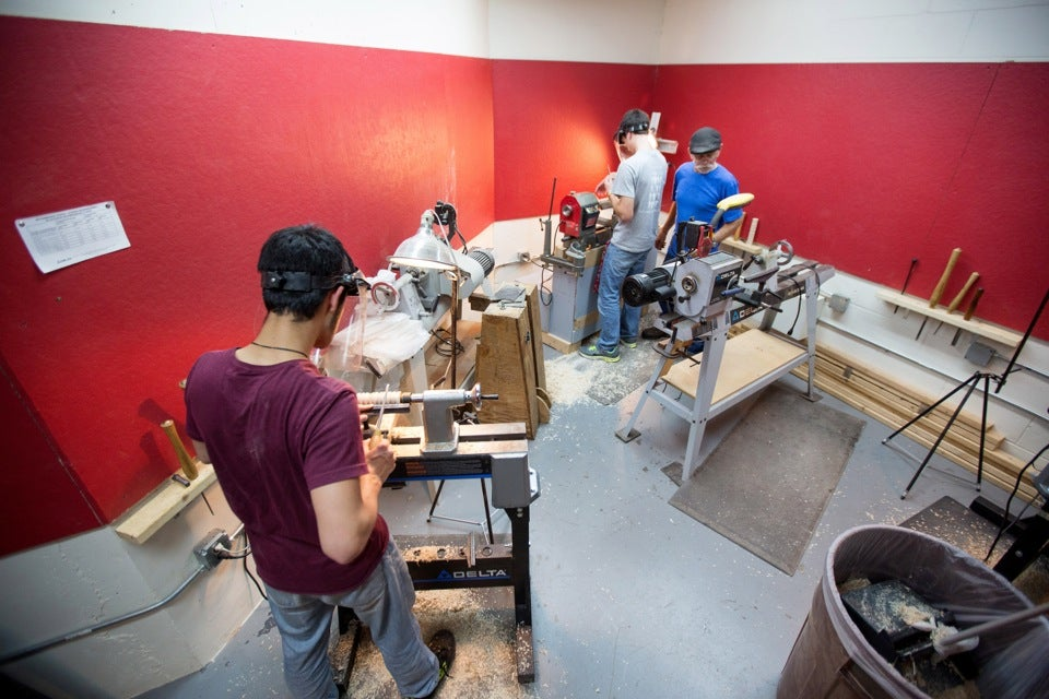 Students work in the Mather House studio using high-end wood for their artistic creations.