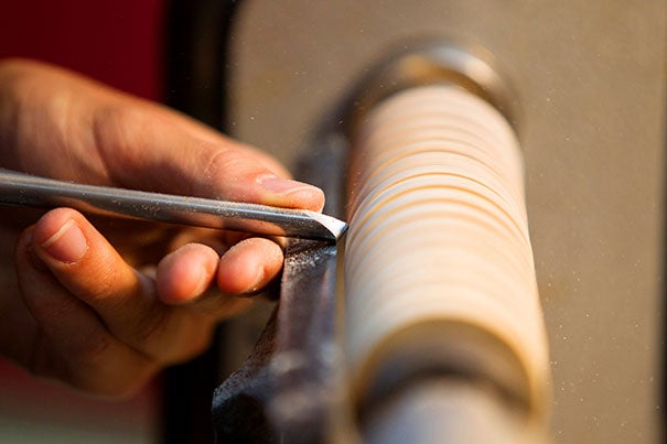 Stephen Mackereth '15 of Mather House practices his wood-turning techniques.