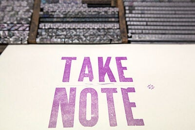 """""""Take Note,"""" a symposium organized by the Radcliffe Institute for Advanced Study, explored the art and importance of effective note taking. As part of the symposium, participants visited the Bow & Arrow Press at Adams House (pictured) and the Harvard University Archives."""