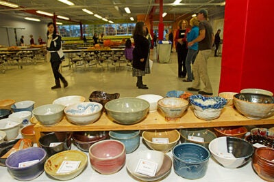 An Empty Bowls fundraiser held at the Harvard Allston Education Portal Annex offered people a unique way to fight hunger. Potters from the Office for the Arts Ceramics Program donated handmade bowls for the event. Guests who purchased tickets sampled food donated by area restaurants and then selected a bowl to take home as a reminder of all the empty bowls in the world.