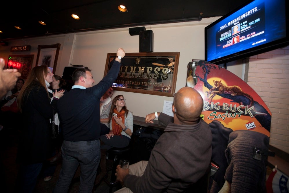 Harvard University Business School students, many in the HBS Democratic Club, celebrated Elizabeth Warren's victory at Whitney's in Harvard Square. Rose Lincoln/Harvard Staff Photographer