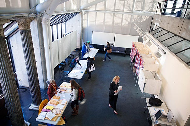 Voters cast their ballots in the Gund Hall polling location at the Harvard Graduate School of Design.