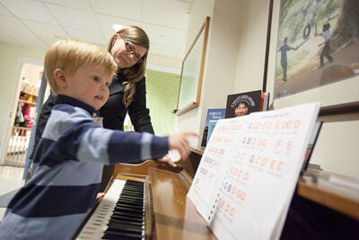 After moving from Wisconsin, Tessa Lowinske Desmond and her husband, Matthew, used the WATCH Portal to help them find child care for their son Sterling. Having easy access to baby sitters who lived on campus was crucial, Desmond said, as she watched Sterling play the piano at the Radcliffe Child Care Center.