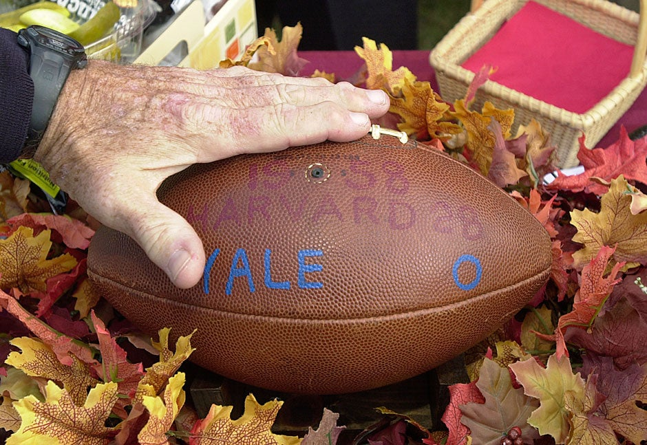 Bob Shaunessy '59 pats the game ball he was given as captain of the team that defeated Yale, 28-0, in 1958. The 121st Harvard-Yale football game in 2004 marked the first occasion he's taken the ball out of his home since the win. Harvard not only beat Yale but also won the Ivy League title in 2004.