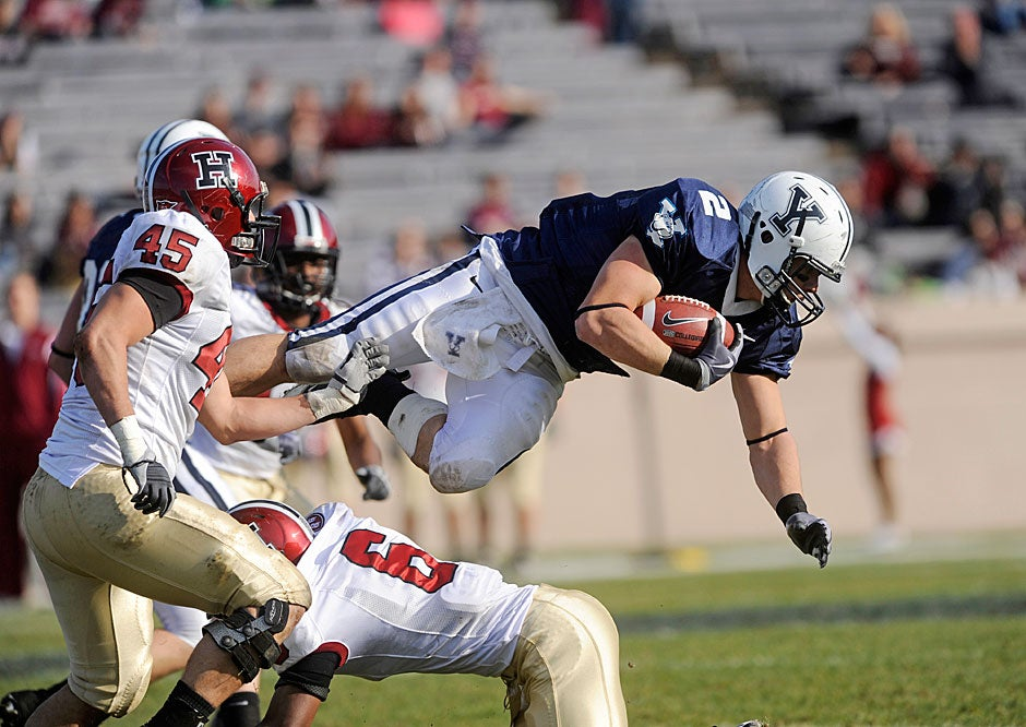 Yale running back John Sheffield gets horizontal after catching a pass and being upended by Crimson defensive back Brian Owusu '13 in 2009. Harvard won, 14-10.