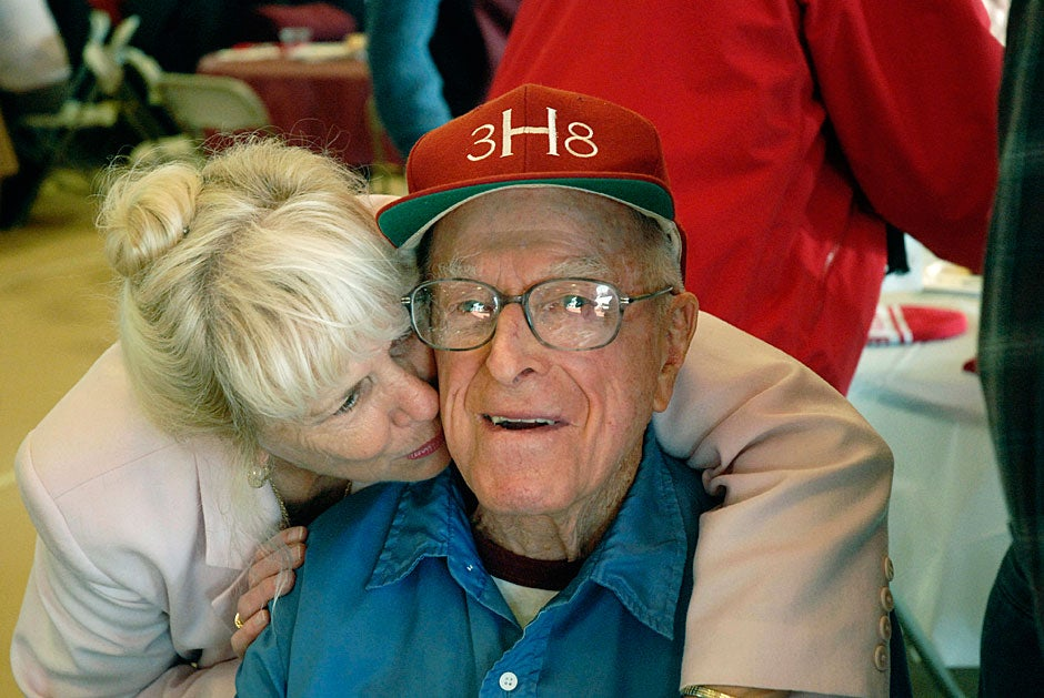 Dick Bennink '38 get a peck from Sylvia Hollister, wife of Vic Koirvumaki '68, before The Game in 2010. Bennink has attended every H-Y game since he graduated, except for the years when he served overseas during WWII. Bennink was 93 when this photo was taken and still travels to The Game from his home in Franconia, N.H.