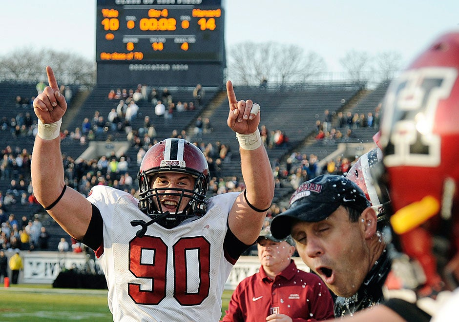 Harvard fullback Kyle Juszczyk '13 rejoices as coach Tim Murphy lets out a shout after being given an ice-cold Gatorade shower at game's end in 2009. Harvard won, 14-10.