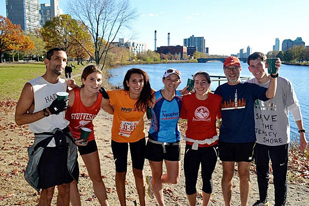 Those who helped get the impromptu marathon rolling included (from left)  Bureau of Study Counsel's Craig Rodgers, Samantha Whitmore '13, Meredith Baker '13, Dunster House tutor Kirsten Scott, Esther Kennedy '13, Professor Daniel Lieberman, and Tyler Cusick '14.