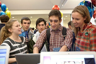 Ammar Joudeh '15 (center) and Claire Stolz '15 (right) test drive a website developed by Stolz and Louise Eisenach '16 (left) that connects Harvard runners looking for company. The  demonstration was part of the annual CS50 Fair, which showcases student projects from the incredibly popular computer science course. Photo by Eliza Grinnell/SEAS