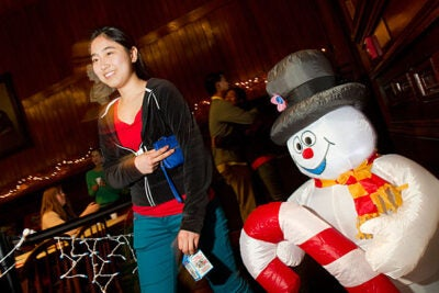 Joanna Wang '16 is in good spirits as she walks into Annenberg Hall  past Frosty the Snowman. Wang joined other freshmen for Winter Fest, a low-key event planned by the First-Year Social Committee.