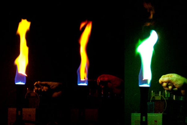 In a series of demonstrations at the SEAS Holiday Lecture, Daniel Rosenberg held filaments of calcium, lithium, and copper in the flame of a Bunsen burner, producing flashes of orange, red, and green.