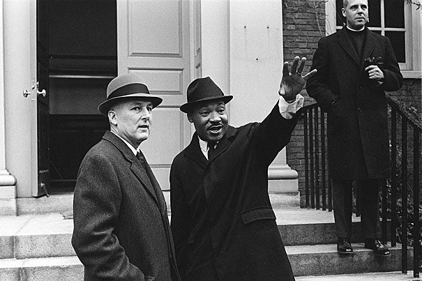 A January visit in 1965 shows Martin Luther King Jr. with Nathan M. Pusey (left), Harvard's 24th president, and the Rev. Charles P. Price on the steps of Appleton Chapel. The visit came just two months before the televised violence of the protest march in Selma, Ala.