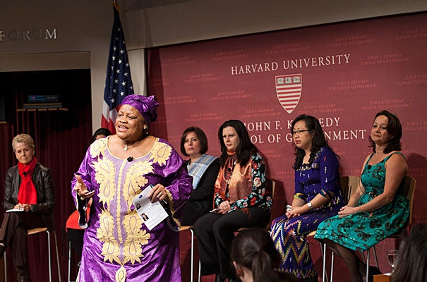 "After ""the women of Liberia got to the [negotiating] table, we've had 10 years of peace,"" Julia Duncan-Cassell (standing), Liberia's minister of gender and development, told a Harvard Kennedy School audience. Among the panelists were moderator Swanee Hunt (from far left), Sabrina Saqeb (not seen), Wafa Bugaighis, Rajaa Altalli, Ja Nan Lahtaw, and Sofi Ospina."