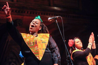 Members of the Harlem Gospel Choir sing in Sanders Theatre as part of the Joyful Noise  concert celebrating Martin Luther King Jr. Day.