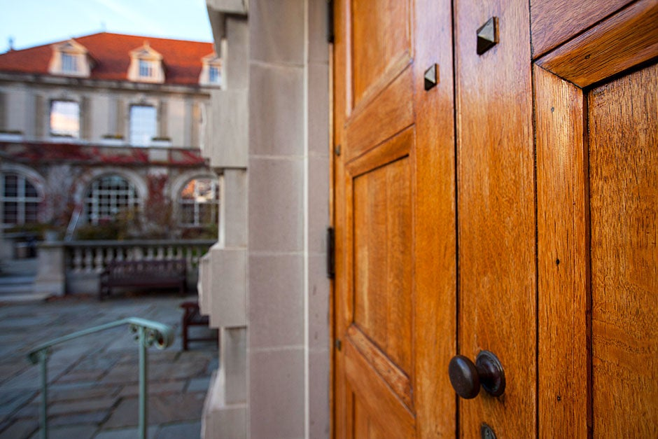 Large oak doors face the courtyard. Busch Hall was built in the spirit of a grand medieval hall and is home to German medieval plaster casts, mostly from churches, as well as the famous Flentrop organ, used for a popular Harvard concert series. Rose Lincoln/Harvard Staff Photographer