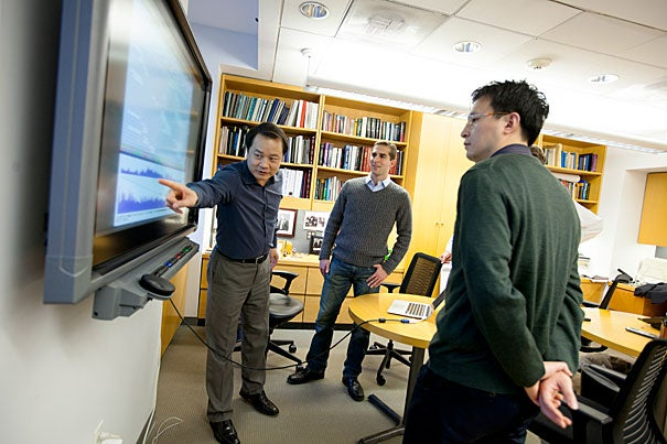 Mallinckrodt Professor of Chemistry and Chemical Biology Xiaoliang Sunney Xie (from left) has co-authored a paper on gene sequencing with graduate student Alec Chapman and postdoctoral fellow Chenghang Zong. The paper demonstrates a new method for DNA amplification that could signal a breakthrough in genomics.