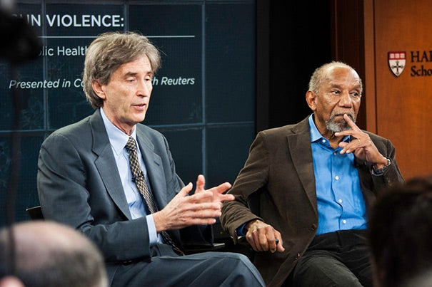 """Data shows that our children are not more violent than other countries', but our kids kill each other. They kill each other because they have access to guns,"" said David Hemenway (left), professor of health policy and management and director of the Harvard Injury Control Research Center. Hemenway was joined at the Harvard School of Public Health (HSPH) panel discussion by Felton Earls, professor of child psychiatry at Harvard Medical School and research professor of human behavior and development at HSPH."