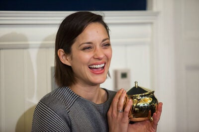 Marion Cotillard claimed her prize at Farkas Hall after a tour of Harvard Yard and a short parade.