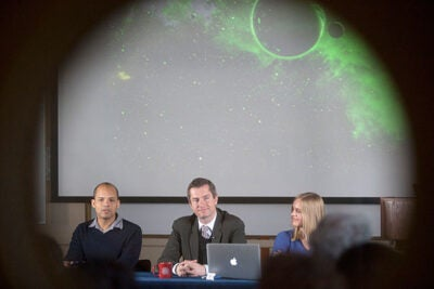 """The nearest Earth-like planet is probably 13 light-years away; astronomically speaking, that's just a stroll across the park,"" said Courtney Dressing (right), a doctoral student in Harvard's Astronomy Department. At the press conference Dressing was joined by Professor David Charbonneau  (center) and John Johnson, an assistant professor of astronomy at the California Institute of Technology."
