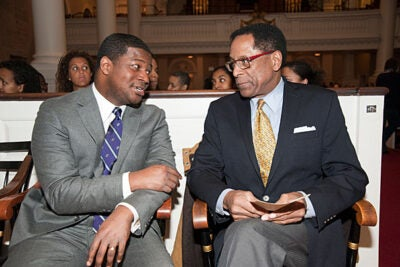 """""""[Martin Luther King Jr.] was always committed to interfaith dialogue, toward the cause of building coalitions toward truth and justice for all of God's people,"""" said the Rev. Jonathan L. Walton (left). S. Allen Counter (right), director of the Harvard Foundation, said the event """"was an opportunity to teach the younger community about the Civil Rights Movement, and what whites, blacks, and Latinos accomplished together."""""""
