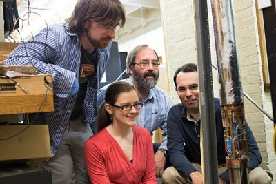 Mason Marshall '16 (from left), Kathryn Marable '16, George Vasmer Leverett Professor of Physics Gerald Gabrielse, and Jack DiSciacca '13 have measured the magnetic charge of single particles of matter and antimatter with unprecedented precision.